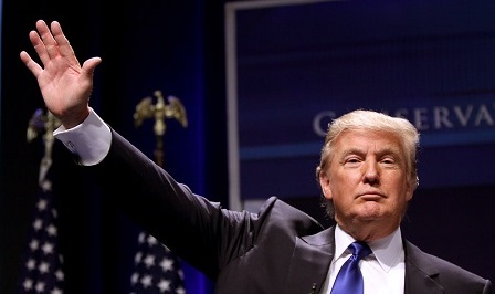 Donald Trump with his hand in the air