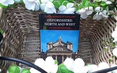 Pevsner book in a bike basket