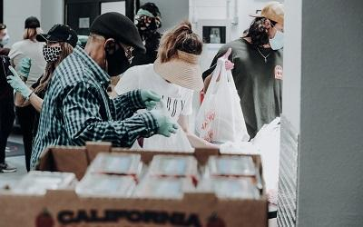 Photo shows a busy foodbank distribution centre, image by Joel Muniz on Unsplash