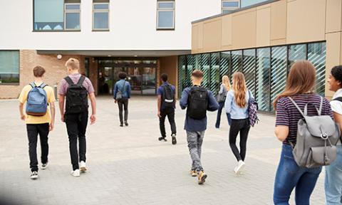 Young people walking into school or college building