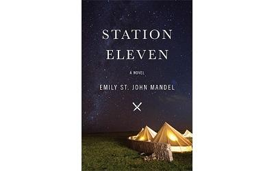Image shows the front cover of the book Station Eleven which shows tent-like images on grass under a dark sky