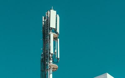 Photo of a mobile phone mast on top of a building