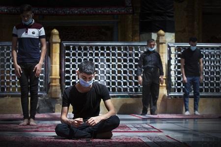 Iraqi youth praying inside the shrine of Al-Abbas