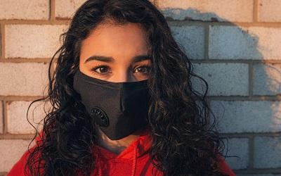 Photo by Gayatri Malhotra on Unsplash - young woman with beautiful brown eyes staring at the camera with a black mask on