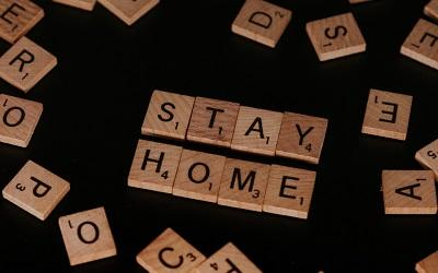 "Scrabble letters spelling ""STAY HOME"""