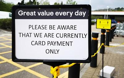 A sign reminding customers they can only use cards
