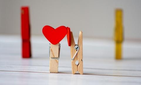Two clothing pegs with felt hearts
